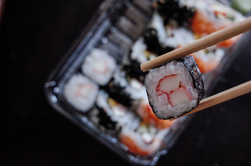 Close-up of chopsticks with sushi