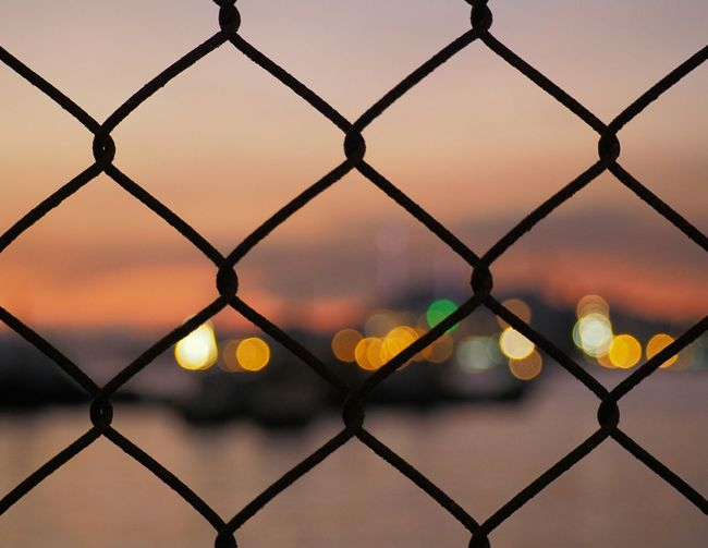 Backgrounds Chainlink Chainlink Fence Close-up Crisscross Day Focus On Foreground Full Frame Metal Nature No People Outdoors Pattern Protection Safety Security Sky Sunset Water