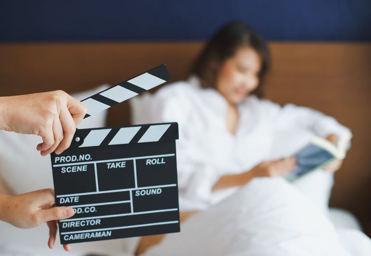 Clapperboard in movie scene Cinema Movie Set Crew Director Production Commercial Television Bedroom Behind The Scenes Actress Actor Slate Board Moviescene Clapperboard Film Industry Indoors  Communication Holding Text Women People Focus On Foreground Television Industry Arts Culture And Entertainment Real People Lifestyles Human Hand