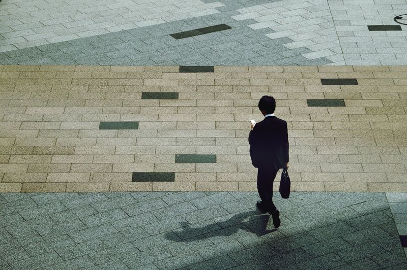 High angle view of man walking in city