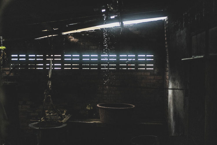 Illuminated lights on wall at night