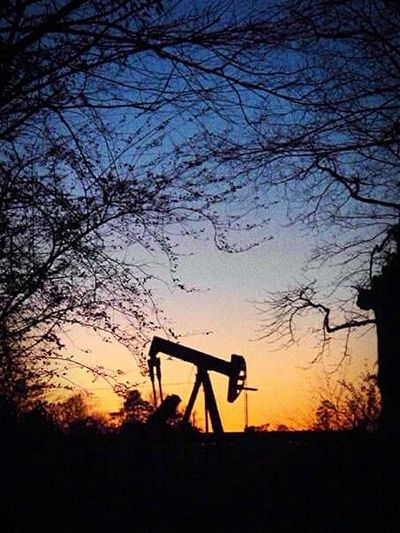 Sunset East Texas Longview, Tx United States Pump Jack With Sun Setting Behind It