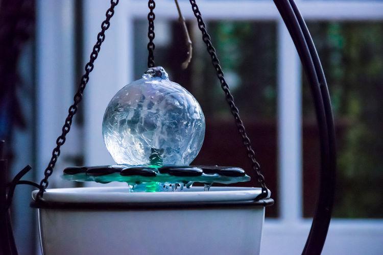 Close-up of crystal ball hanging at home
