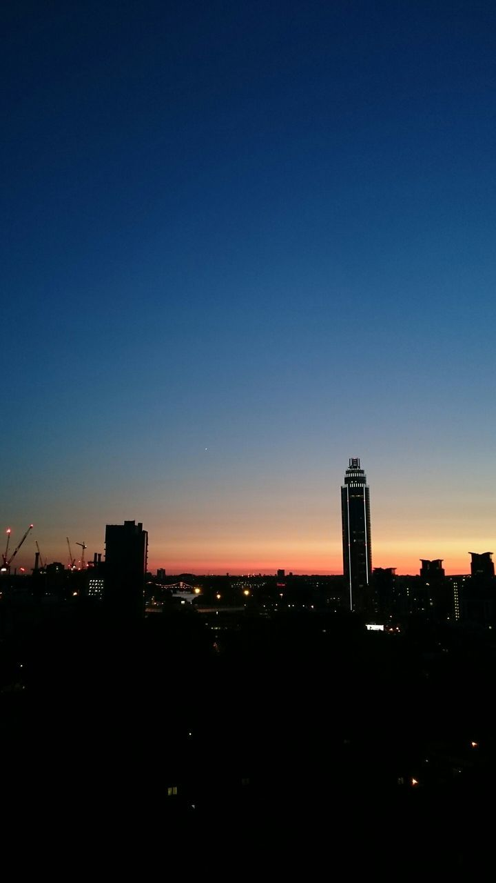High angle view of silhouette cityscape against sky during sunset