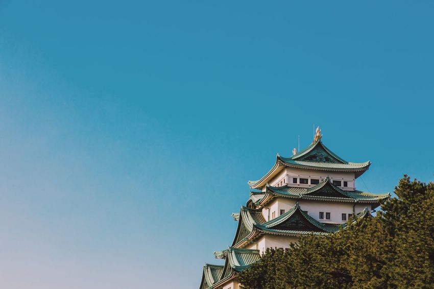 VSCO Nagoya Streetphotography Architecture Built Structure Building Exterior Clear Sky Sky Low Angle View Copy Space No People Blue Building Nature Day Outdoors Travel