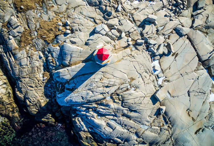 Directly Above Shot Of Peggy Cove Lighthouse On Rocky Mountain