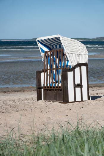Absence Beach Chair Day Horizon Horizon Over Water Land Nature No People Outdoor Chair Outdoors Sand Sea Seat Sky Striped Summer Tranquil Scene Tranquility Water