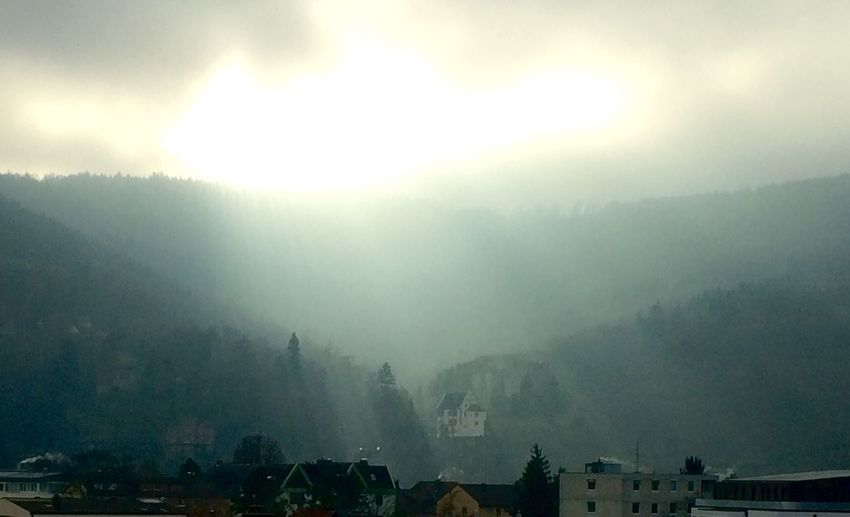 Lichtblicke in Miltenberg Fog Sky Sunbeam Architecture Sun Building Exterior Outdoors Nature No People Day Built Structure Beauty In Nature Mountain Tree Scenics Cityscape