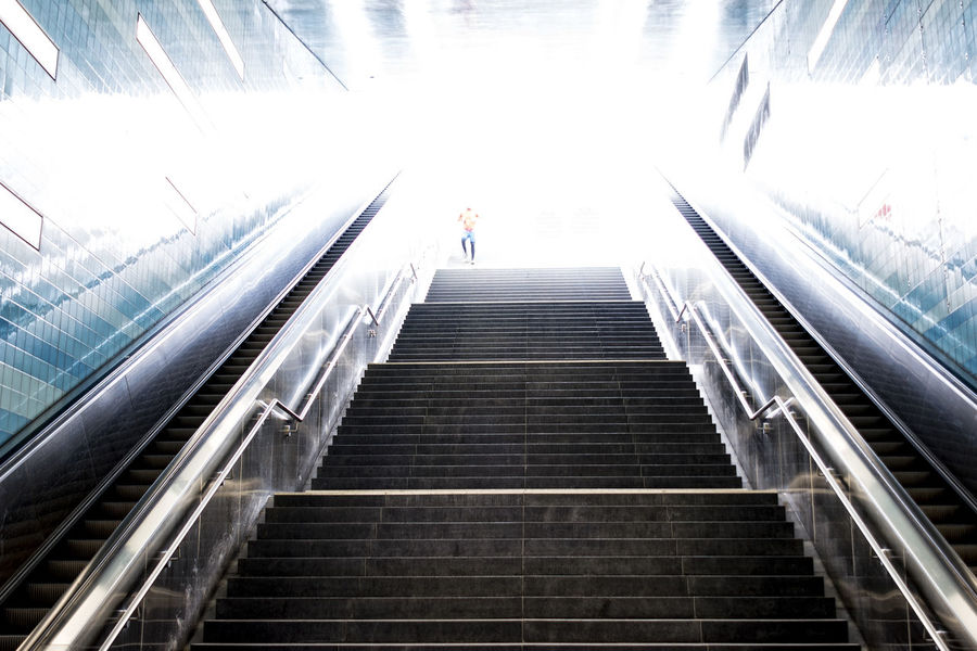 man against the light Against The Light Architecture Backlighting Built Structure Day Escalators And Staircases Full Length Hafencity Hamburg Hamburg Hand Rail Indoors  Lifestyles Low Angle View Modern One Person People Railing Real People Staircase Steps Steps And Staircases The Way Forward Wall
