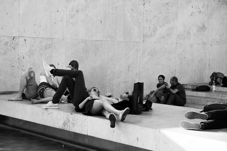 Group Of People Relaxation Sitting Leisure Activity Casual Clothing Lying On Back Teenager Teenage Boys Togetherness Friendship People Lying Down Lifestyles EyeEm Streets Eyeem Streetphotography EyeEm Gallery