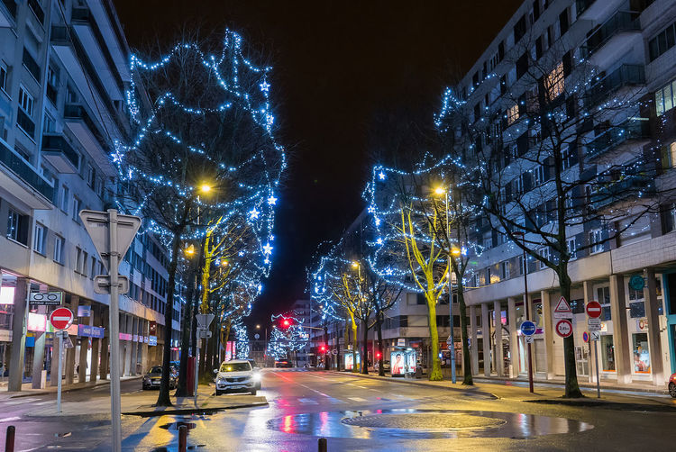 Architecture Bare Tree Building Exterior Built Structure Car City City Life Illuminated Long Exposure Motion Night No People Outdoors Road Sky Speed Street Street Light The Way Forward Transportation Tree