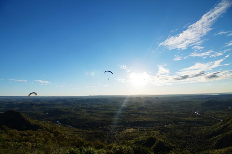 The Great Outdoors - 2017 EyeEm Awards Flying Outdoors Sky Landscape Scenics Beauty In Nature Clear Sky Paragliding People And Places Extreme Sports Flying High Sunset Sun Valley Mountains RISK Adrenalin Panoramic