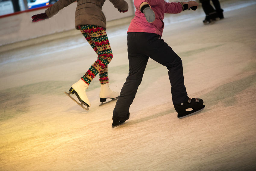 Balance Day Ice Rink Ice Skate Ice Skates Ice Skating Indoors  Leisure Activity Lifestyles Low Section Men People Real People Skateboard Skill  Togetherness Two People Women