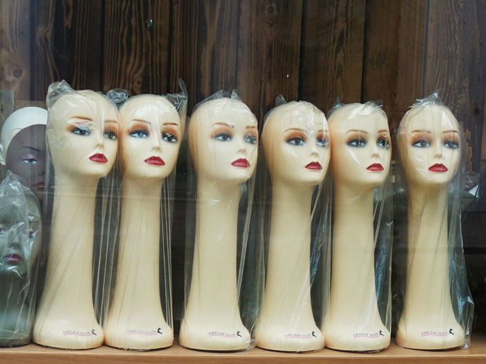 long necks Close-up Faces For Sale Human Representation In A Row Indoors  Long Neck  Necks No People Retail  Store