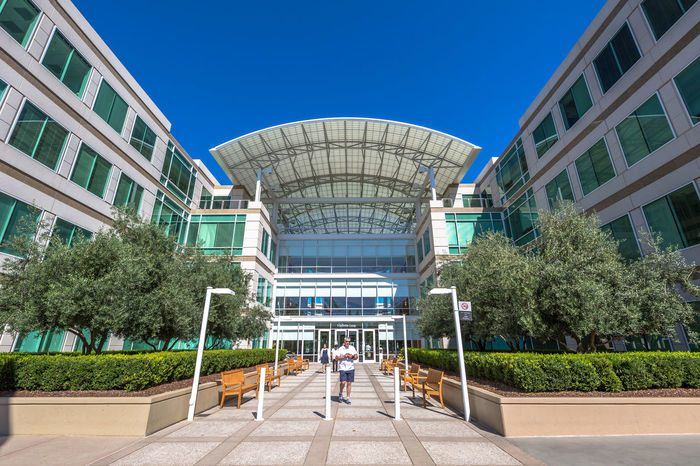 Cupertino, California, United States - August 15, 2016: the Apple world headquarters at One Infinite Loop. Apple is a multinational that produces consumer electronics, personal computers and software. people come from the popular Apple store of Apple Inc Headquarters at One Infinite Loop located in Cupertino, Silicon Valley, California. Apple California IT Mac PC United States Adult Architecture Blue Building Building Exterior Built Structure City Clear Sky Computer Cupertino Day Electronics Industry Flag Full Length Futuristic Headquarter Headquarters Hq IMac27 IPhone Imac Infinite Loop Men Mobile Modern Outdoors People Real People Sky Store Tree Walking Women