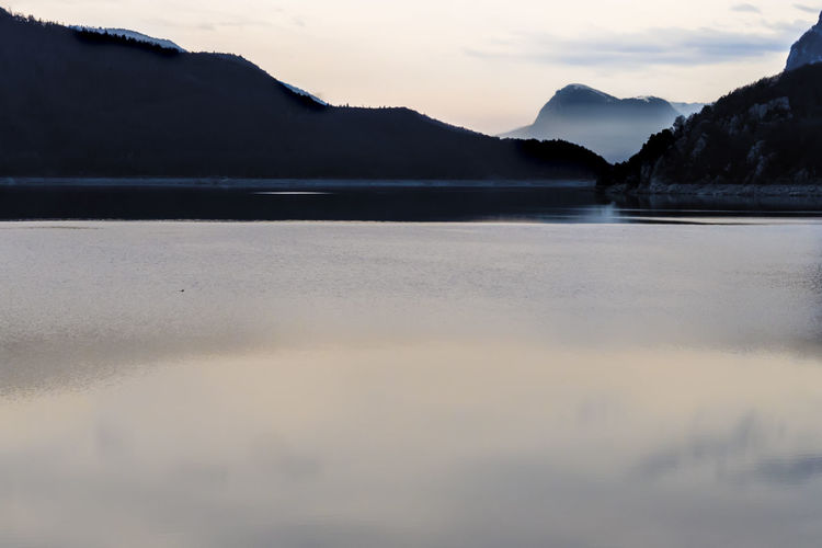 Water gray Sky Mountain Beauty In Nature Water Tranquility Tranquil Scene Scenics - Nature Cloud - Sky Waterfront Lake Nature No People Reflection Mountain Range Idyllic Non-urban Scene Outdoors Day Mountain Peak Molveno Lake Molveno See Trentino Alto Adige
