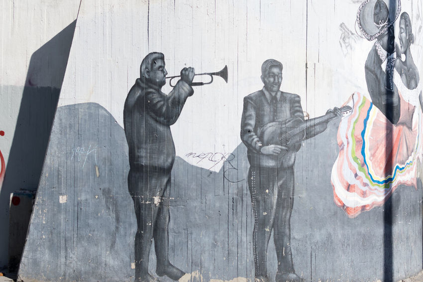 Mexican Mariachi Adults Only Communication Cooperation Coworker Day Guadalajara Holding Light And Shadow Mariachi Men Mexico Mural Mural Art Musician Outdoors Paint People Performing Arts Event Shadow Standing Streetphotography Teamwork The City Light Togetherness Wall