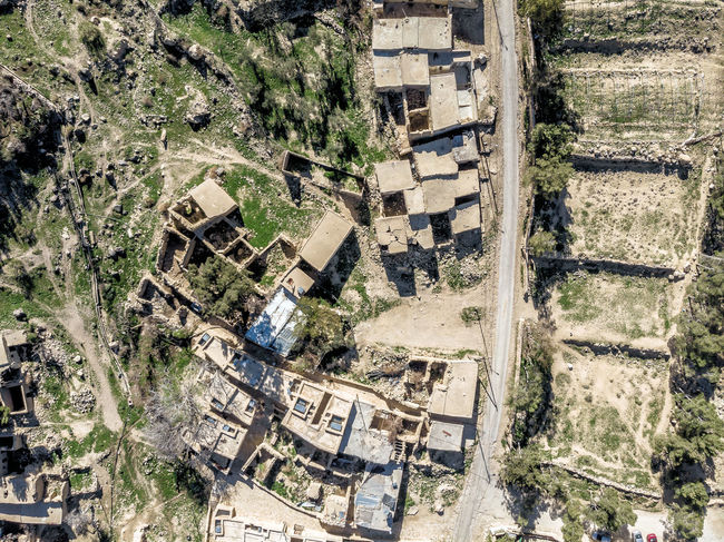 Aerial view of the village Dana and its surroundings at the edge of the Biosphere Reserve of Dana in Jordan Desert Drone  Hiking Houses Jordan Nature Panoramic Rocky Aerial View Biosphere Canyon Dana Reserve Ecology Landscape Mountain Protected Reserve Tourism Valley Village Wadi Dana Wilderness