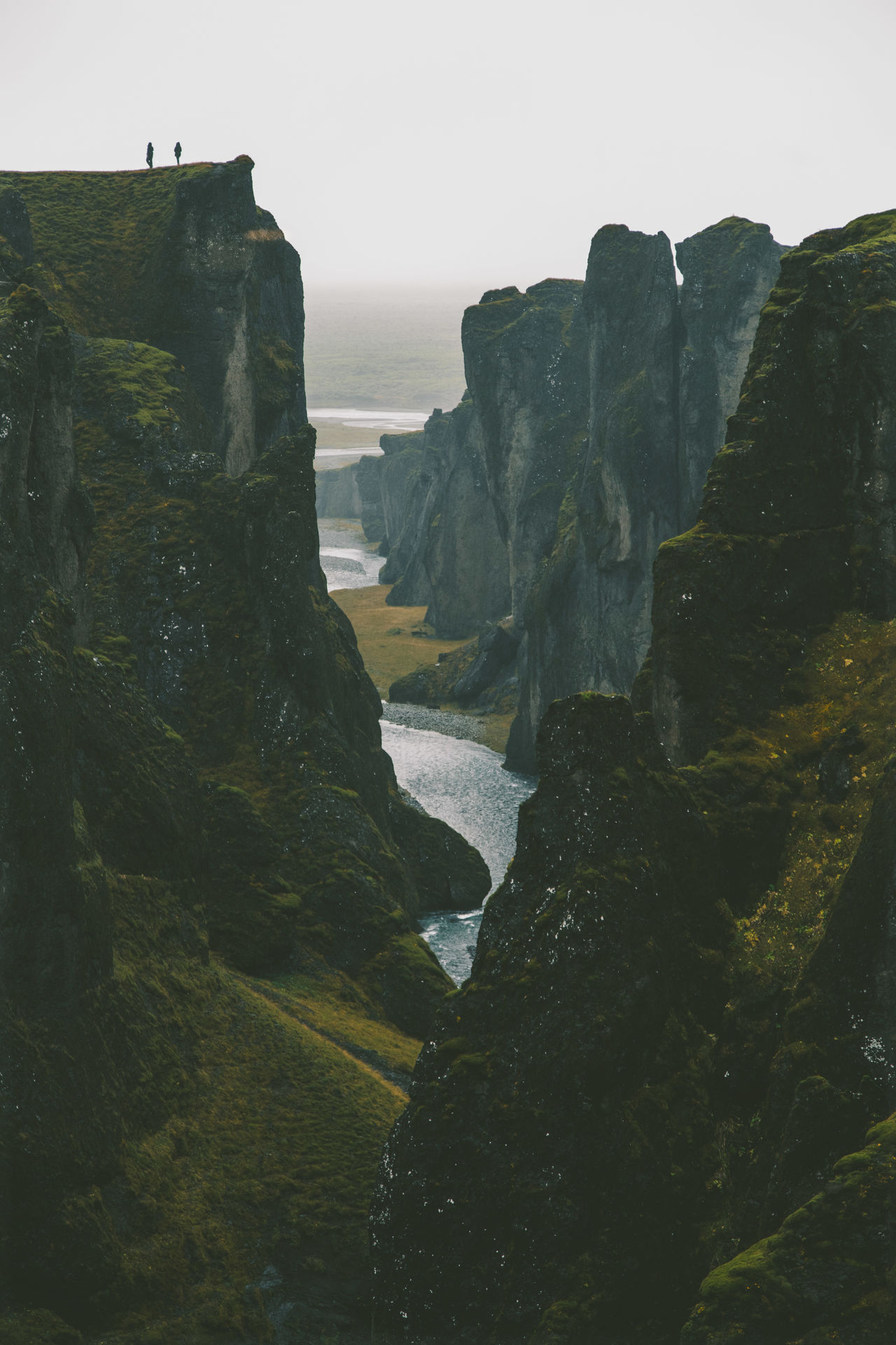 Scenic view of river among cliffs