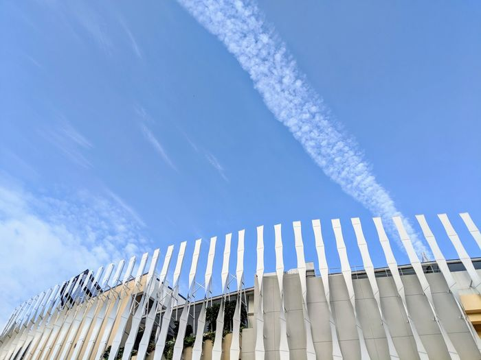 Looking up Low Angle View Day Sky No People Outdoors Building Exterior Vapor Trail