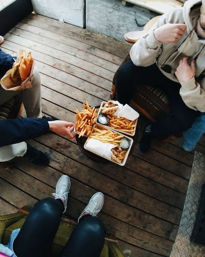 Low section of people eating food