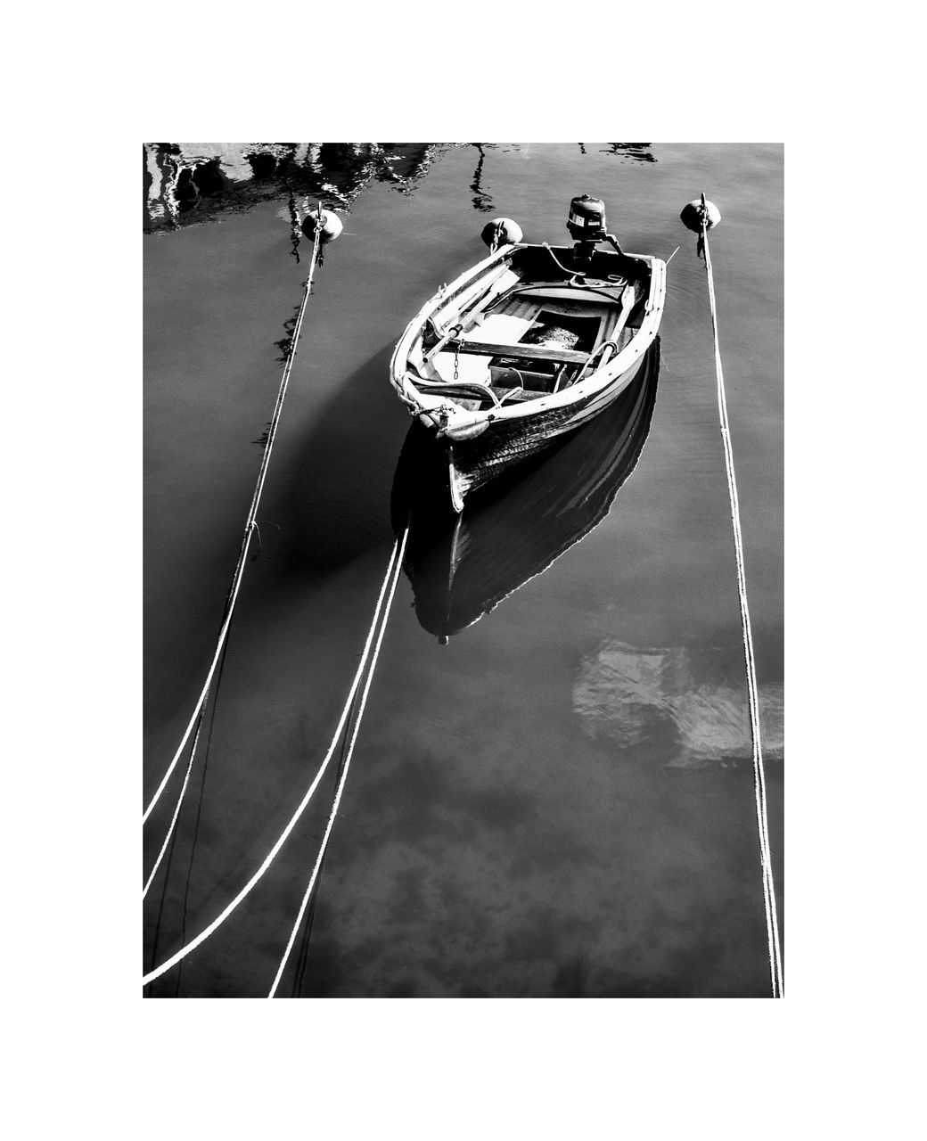 HIGH ANGLE VIEW OF SAILBOAT ON ROPE OVER RIVER