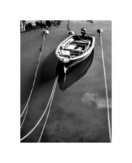 High angle view of sailboat on rope