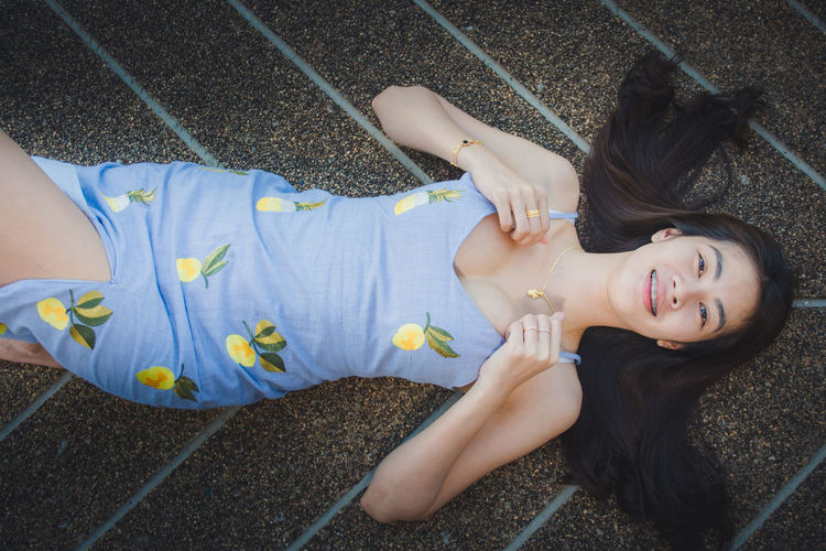 Smiling Lying Down Real People High Angle View Happiness Portrait Leisure Activity Emotion Women Casual Clothing Lifestyles Looking At Camera Young Adult Child People Young Women Toothy Smile Togetherness Teeth Hairstyle Outdoors Positive Emotion