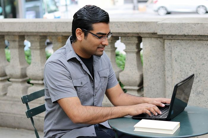 Handsome young man using laptop and reading in urban city outdoor park American College Computer Concentration Cyberspace Day Hacker Hairstyle Handsome Indian Internet Laptop New York City Notebook One Person Outdoors Park Reading Student Studying Technology Typing Using Laptop Wireless Technology Young Adult