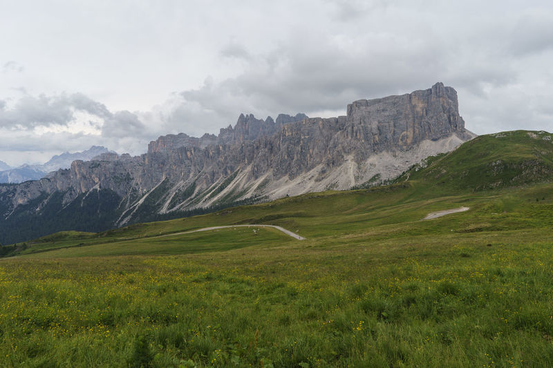 Day Grass Landscape Mountain Nature No People Outdoors Sky Italy Passo Giau Dolomites Clouds Peak Field Valley Alps