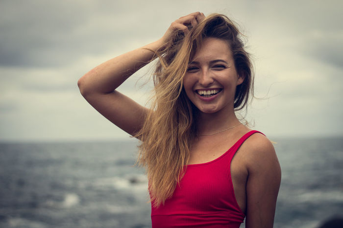 Benijo Beach Beautiful Woman Beauty In Nature Day Front View Happiness Horizon Over Water Leisure Activity Lifestyles Long Hair Looking At Camera Nature One Person Outdoors People Portrait Real People Sea Sky Smiling Tank Top Water Young Adult Young Women Be. Ready.