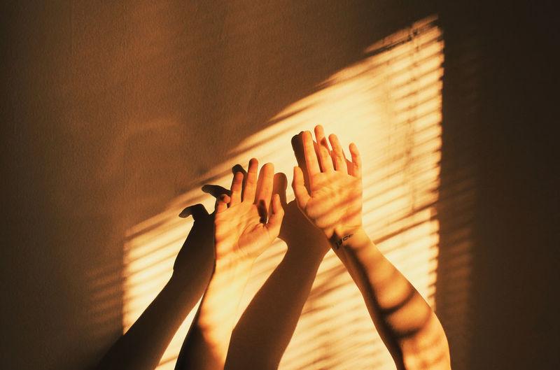 Human Hand Shadow Sunlight Reaching Gesturing Palm Close-up Human Finger