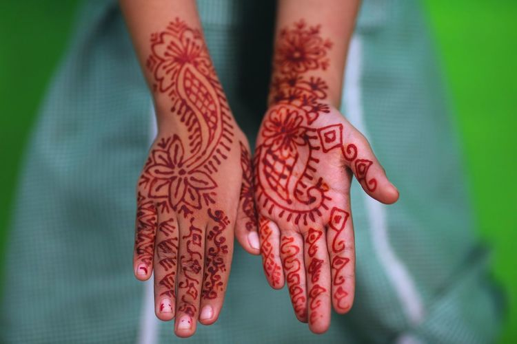 Cropped Image Of Person Showing Henna Tattooed Hand
