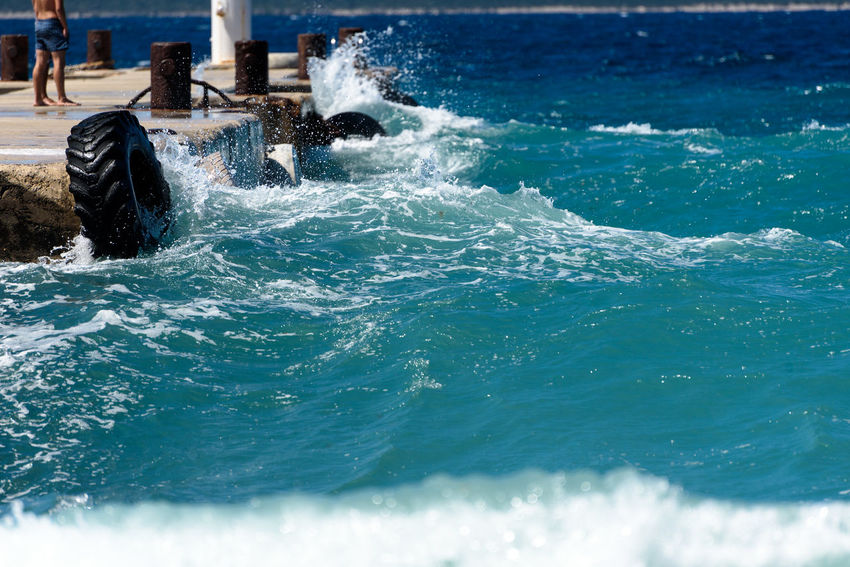 Strong winds and waves are hitting a pier in harbor. Port in Silba Croatia is experiencing bad windy weather. Bad Weather Big Waves Croatia Harbor Pier Storm Weather Winds Adriatic Sea Blue Danger Danger At Sea Day Dock Nature Ocean Outdoors Port Sea Silba Strong Waves Water Waves Wind