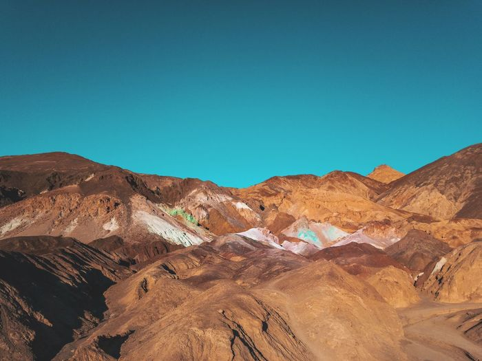 Artists Palette -> Death Valley Roadtrip Sightseeing Colorful Artists Pallet Death Valley No People Mountain Day Outdoors Desert Nature Blue Landscape Clear Sky Arid Climate Sky