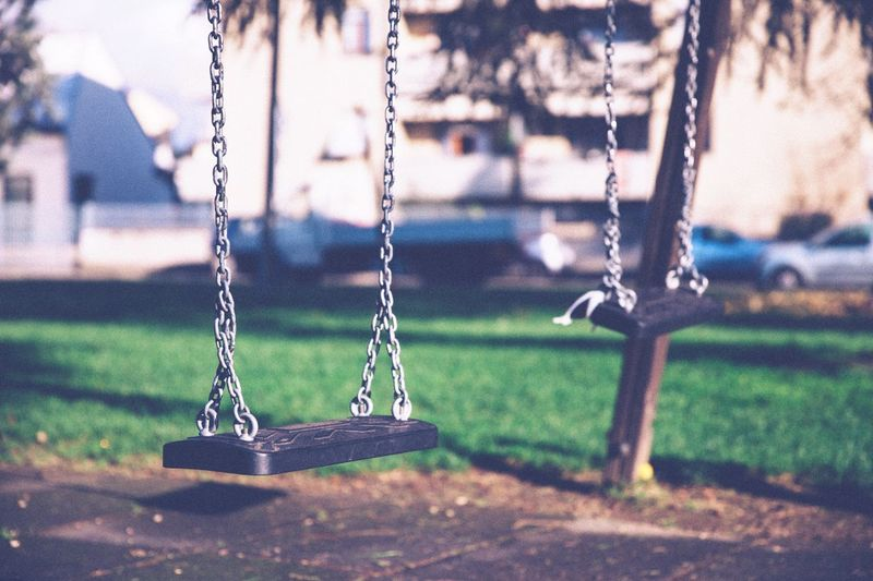 Swing Focus On Foreground Swing Chain No People Outdoors Close-up Day Lonely Melancholy Melancholic Seesaw Teeter-totter Vintage Film Filmisnotdead Film Photography Park Urban Urban Exploration Urbanphotography Urban Photography