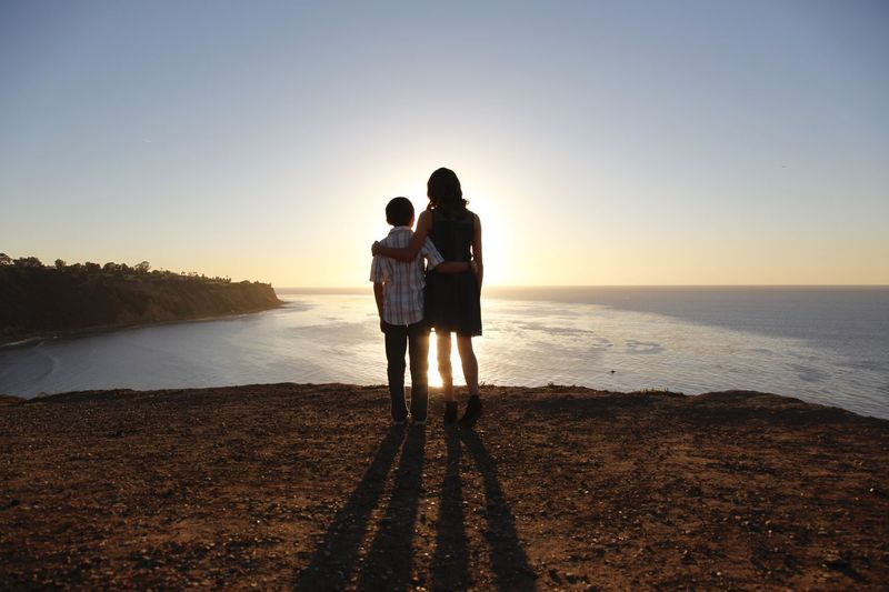 Beach Horizon Over Water Love Nature Outdoors Real People Sea Sibling Love Siblings Silhouette Sky Standing Sunset Togetherness