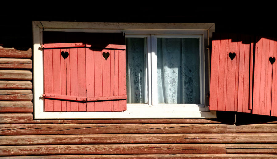 Heart Shapes On Wooden Window Of Old House