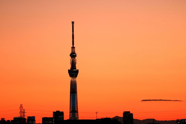 Tokyo sky tree against orange clear sky