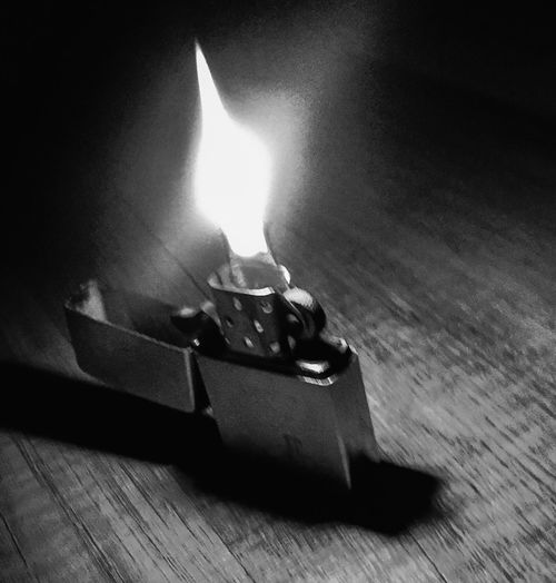 Zippo lighter Black And White Blackandwhite Flame Fire Burning Fire - Natural Phenomenon Heat - Temperature Indoors  No People Nature Table Wood - Material Glowing Close-up High Angle View Motion Environment Shadow Still Life Candle Event Sign