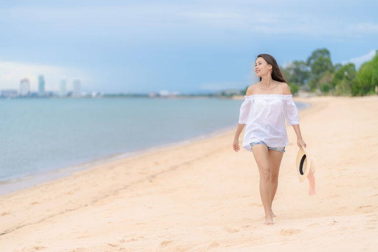 Full length of young woman on beach