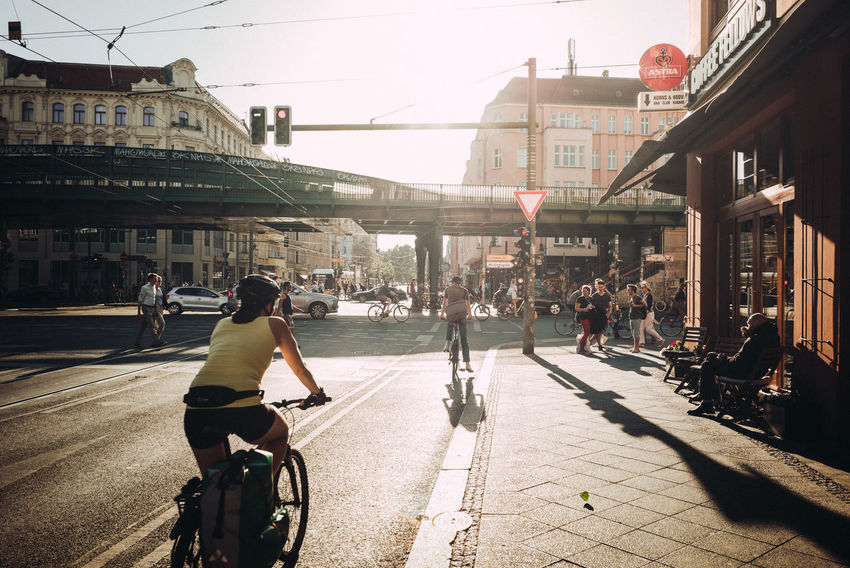 Bicycle traffic in the rush hour The Street Photographer - 2018 EyeEm Awards Urban Geometry Architecture Bicycle Building Building Exterior Built Structure City City Life City Street Day Group Of People Incidental People Land Vehicle Lifestyles Men Mode Of Transportation Nature Outdoors People Real People Street Sunlight Transportation Urban