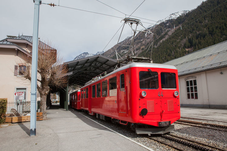 Train At Platform With Mountain In Background