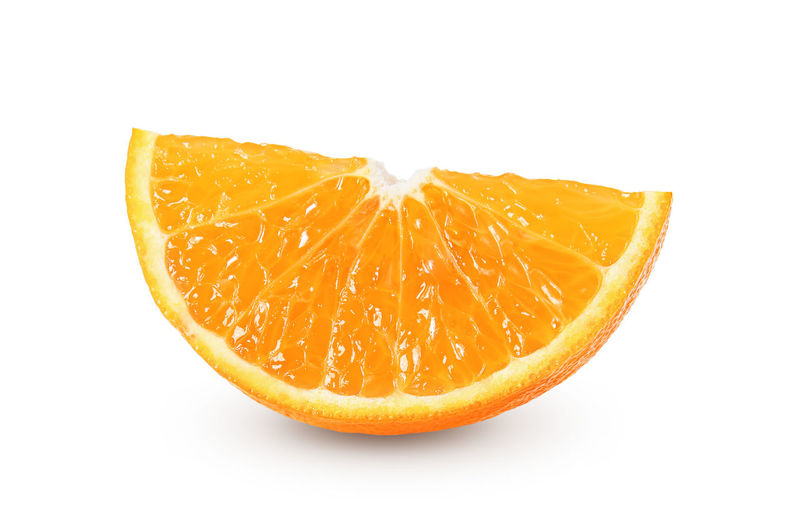 Close-up of orange fruit against white background