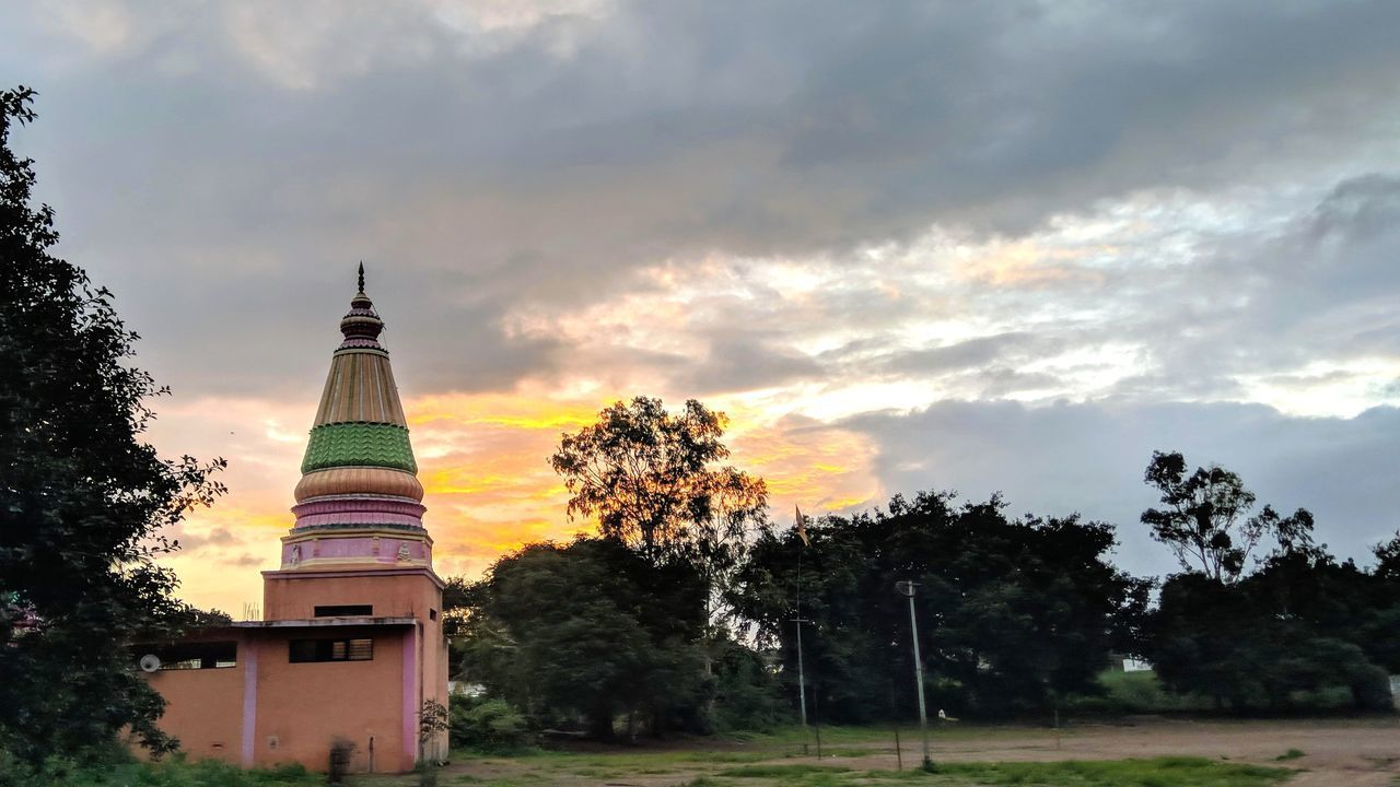 sky, tree, cloud - sky, plant, architecture, nature, no people, built structure, building exterior, building, belief, religion, tower, place of worship, travel destinations, outdoors, sunset, spirituality, growth, spire