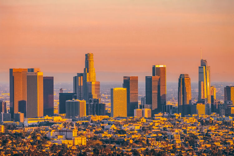 Downtown LA Skyline Building Exterior Architecture Built Structure City Building Office Building Exterior Sunset Cityscape Sky Skyscraper Urban Skyline Orange Color Modern Landscape No People Nature Tower Residential District Tall - High Office Financial District  Outdoors
