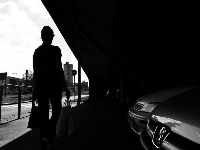Black & White Blackandwhite Black And White IPhoneography Monochrome Personal Perspective Perspective Darkness And Light Light And Shadow Light Up Your Life Contrasts Lines And Shapes Silhouette Woman Women Who Inspire You Street Road Crosswalk People Walking City City Life Architecture Streetphotography