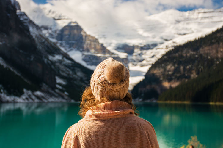 Woman admiring the view at Lake Louise on a sunny day Alberta Wanderlust Beauty In Nature Canada Lake Louise  Leisure Activity Lifestyles Mountain Mountain Range Nature One Person Real People Rear View Scenics - Nature Tranquil Scene Travel Destinations Water My Best Travel Photo