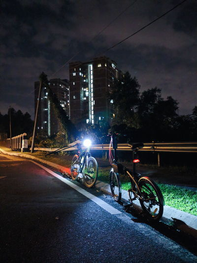 Bicycles on road in city at night