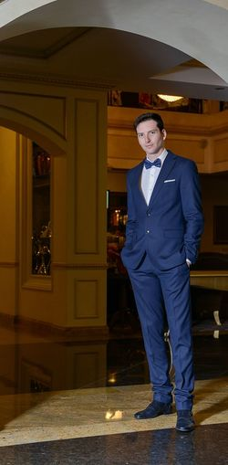 Portrait of businessman standing on tiled floor